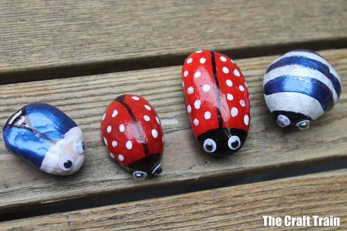 bugs created from garden pebbles and nail polish. THese are perfect to scatter around the garden as decorations! #bugs #kidscrafts #rockart #insects #minibeasts #ladybugcraft