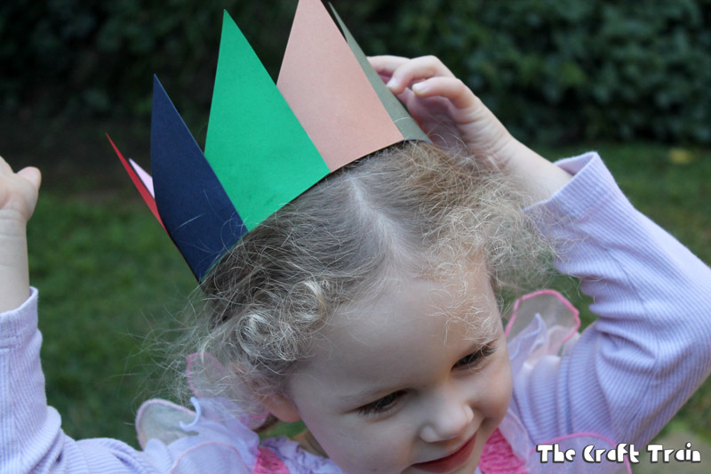 Paper scrap crown made from triangles layered over each other