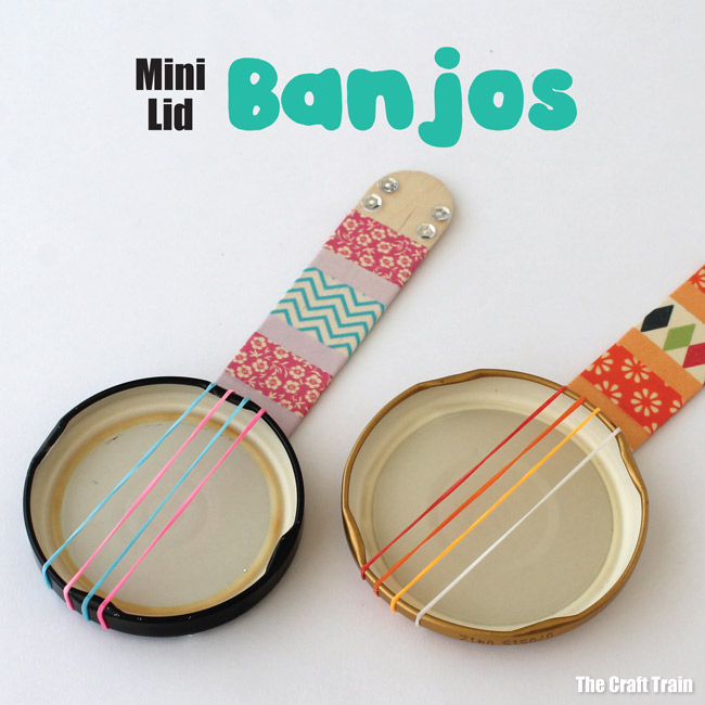 Mini lid banjos - repurpose old jar lids into a cute DIY toy. THese miniature banjos are a fun stem or steam craft idea for summer!. Also a great musical instrument craft for kids #musicalinstrument #recycle #recyclingcraft #kidscraft #diytoy #jarlids #craftsticks #banjos #diy #thecrafttrain