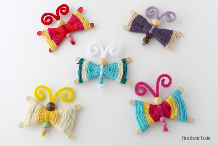 yarn butterflies, a fun kids craft for spring made using a simple weaving technique