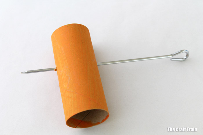 poking holes in the paper roll