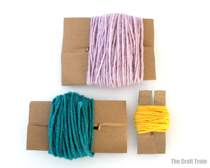 wrap yarn around your pom pom maker