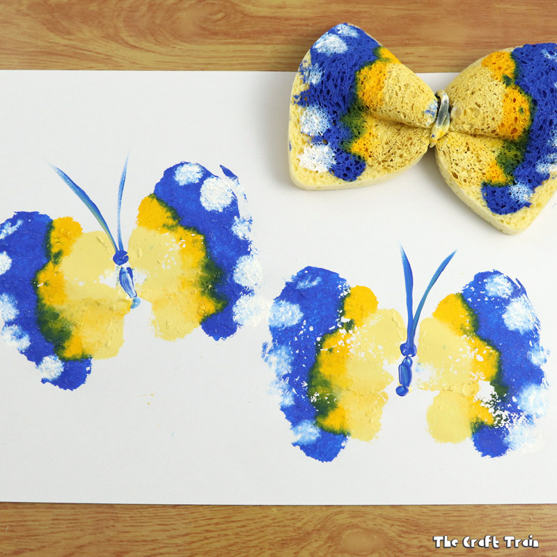 Create colourful, fun butterfly prints with a kitchen sponge tied with a hair elastic
