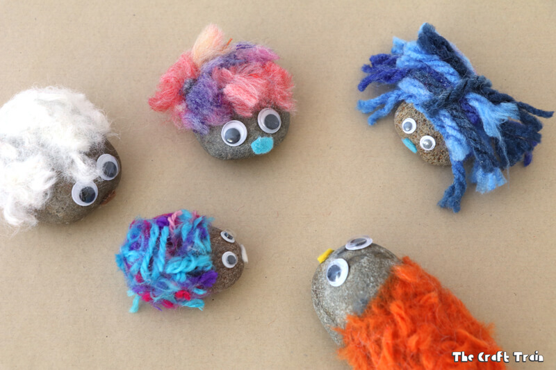 Create adorable fluffy pet rocks with pom pom trimmings. This is a simple rock craft idea for kids and makes a cute kid-made gift idea