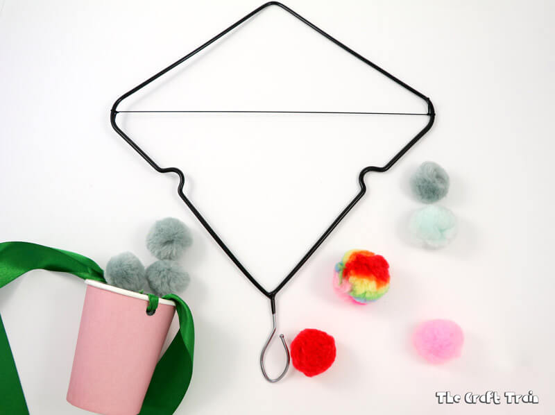 Coat hanger catapult craft: Make a simple catapult by upcycling a wire coat hanger. This is a fun STEAM activity for kids which also makes a great DIY toy.