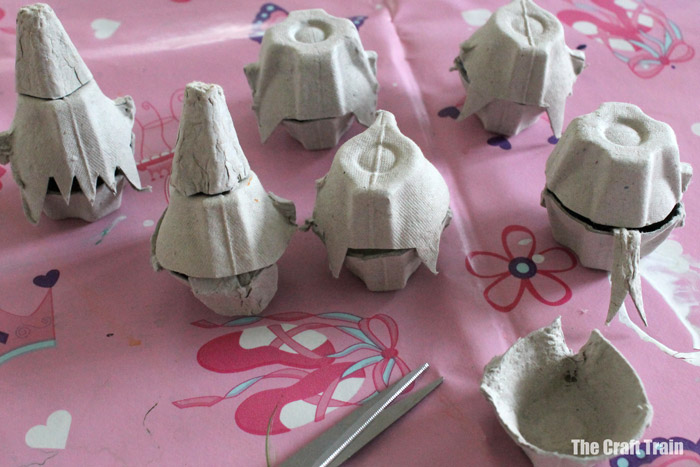 Cutting up egg cartons to make monster treat holders