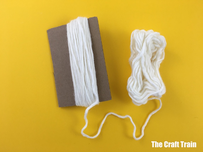 wrap the yarn around a cardboard scrap
