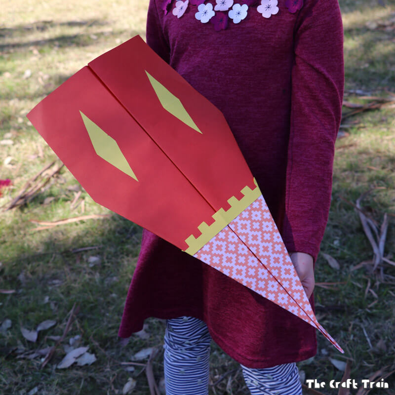 Make scrapbook paper planes and fly them outdoors!