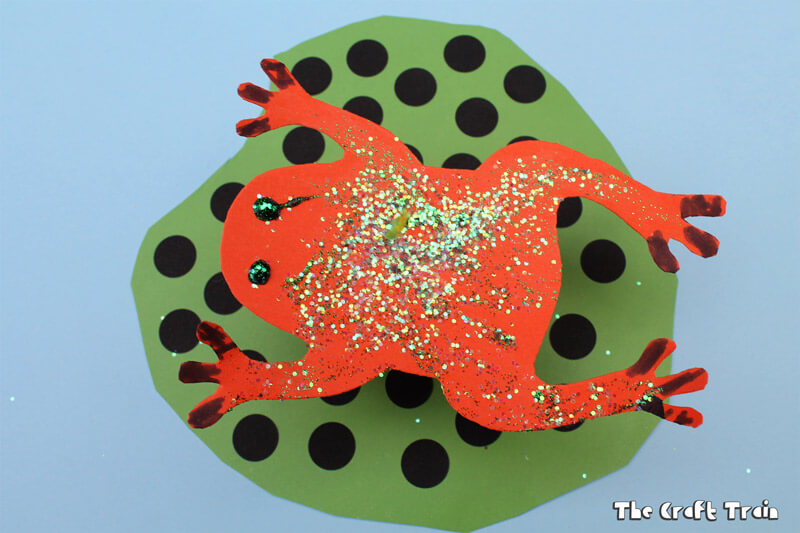 Kid made frog on a lily pad craft