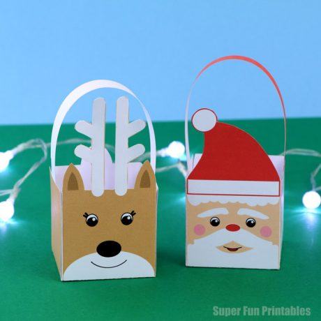 Easy printable Christmas baskets kids can make. These come in both reindeer and Santa designs and have a full colour and black and white version so kids can colour their own. THey would make a lovely handmade gift idea with a small treat or gift inside #christmascrafts #christmasprintables #Santa #reindeer #kidscraft #kidsactivities