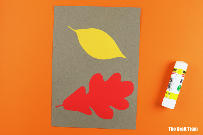 Glue paper leaves onto a contrasting colour