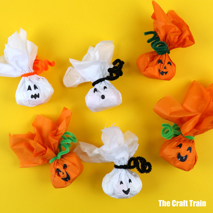 DIY Halloween treats, ghost and pumpkin themed. Cute to hand out to trick or treaters!