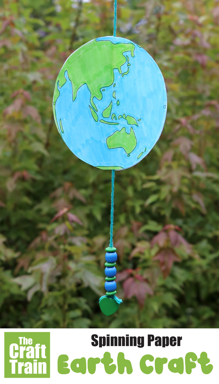 Spinning paper earth craft for kids. Make a paper earth that spins in the breeze using this printable template