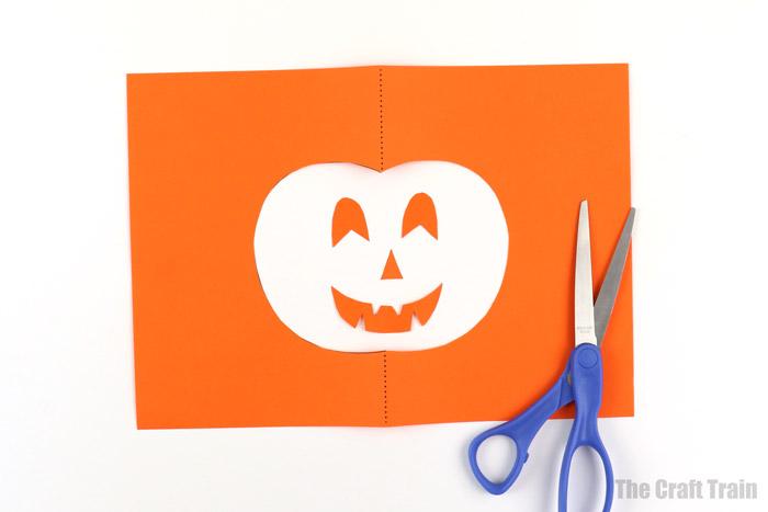cut out the paper pumpkin shapes