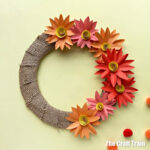 Fall wreath craft made from paper flowers and burlap