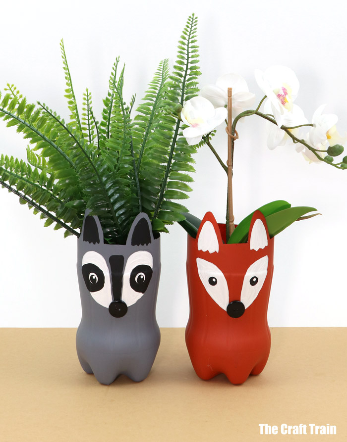 woodland animal planters made from recycled plastic bottles in a fox and raccoon design