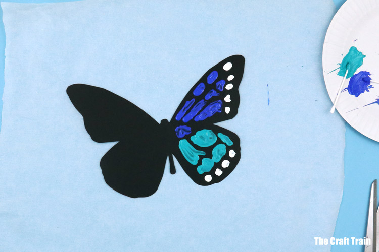 symmetrical butterfly painting Spring art project