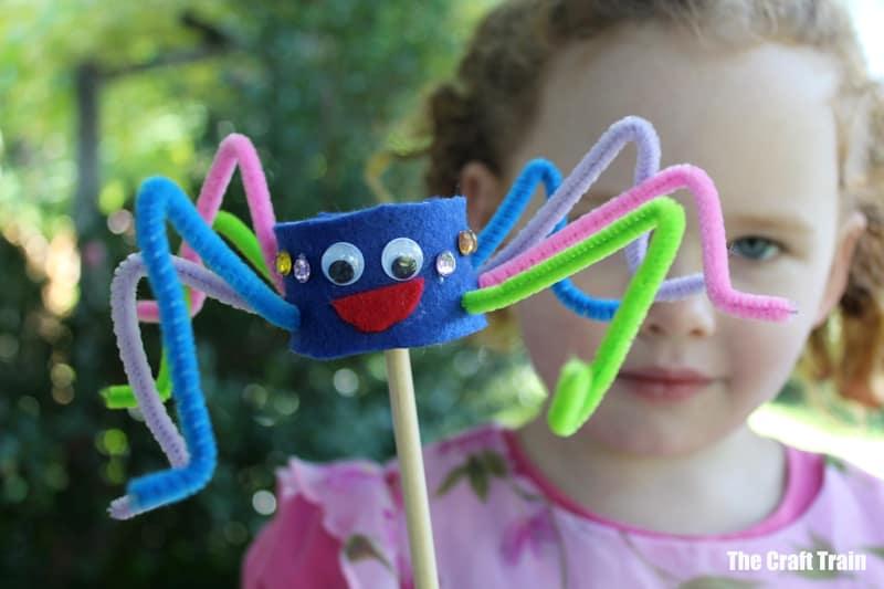 kids with her handmade spider puppet