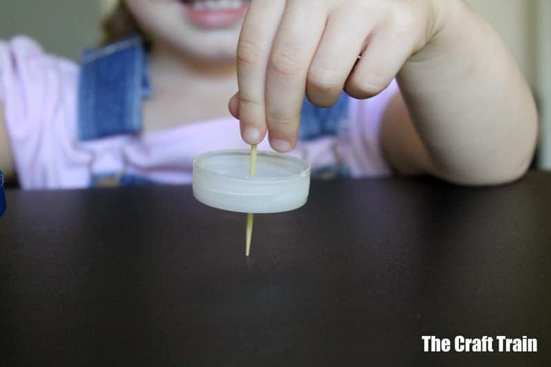 milk bottle cap spinning top DIY for kids